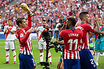Antoine Griezmann, Thomas Lemar and Lucas Hernandez of Atletico Madrid with the trophy of the world cup, won with the French team in the last world cup in Russia before the match between Real Madrid v Rayo Vallecano of LaLiga, 2018-2019 season, date 2. Wanda Metropolitano Stadium. Madrid, Spain - 25 August 2018. Mandatory credit: Ana Marcos / PRESSINPHOTO