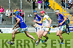 Kilmoyley's Sean Maunsell with Lixnaw's Pat Corridon, Gerard Stackpoole and Darragh Shanahan giving chase  in the Garveys Supervalu Senior County Hurling Championship Round 3 Kilmoyley V Lixnaw at Austin Stacks Park on Sunday