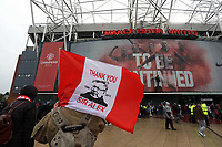 "Pictured: A man holding a ""Thank you sir Alex"" flag outside the ground before kick off. Sunday 12 May 2013<br />