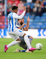 Huddersfield Town's Josh Koroma is tackled by Lincoln City's Michael Bostwick<br /> <br /> Photographer Chris Vaughan/CameraSport<br /> <br /> The Carabao Cup First Round - Huddersfield Town v Lincoln City - Tuesday 13th August 2019 - John Smith's Stadium - Huddersfield<br />  <br /> World Copyright © 2019 CameraSport. All rights reserved. 43 Linden Ave. Countesthorpe. Leicester. England. LE8 5PG - Tel: +44 (0) 116 277 4147 - admin@camerasport.com - www.camerasport.com