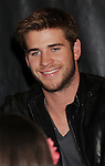 LOS ANGELES, CA - MARCH 22: Liam Hemsworth of Lionsgate's 'The Hunger Games' poses at Barnes & Noble at The Grove on March 22, 2012 in Los Angeles, California.