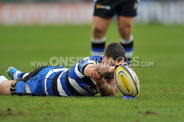 Matt Banahan holds the ball steady during a shot at the posts. Aviva Premiership match, between Bath Rugby and Newcastle Falcons on February 8, 2014 at the Recreation Ground in Bath, England. Photo by: Patrick Khachfe / Onside Images