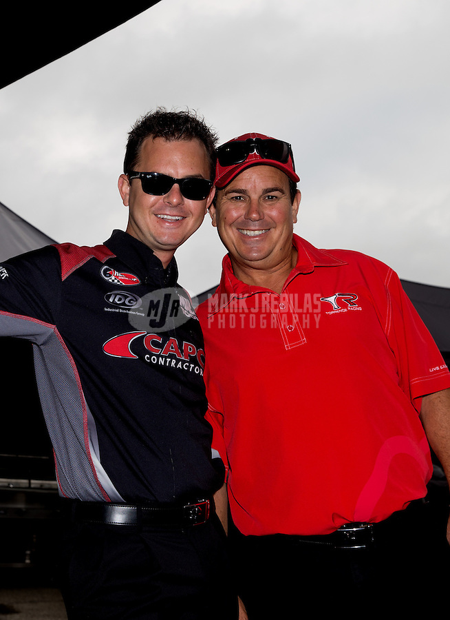 Sept. 1, 2013; Clermont, IN, USA: NHRA top fuel dragster driver Billy Torrence (right) with his son Steve Torrence during qualifying for the US Nationals at Lucas Oil Raceway. Mandatory Credit: Mark J. Rebilas-