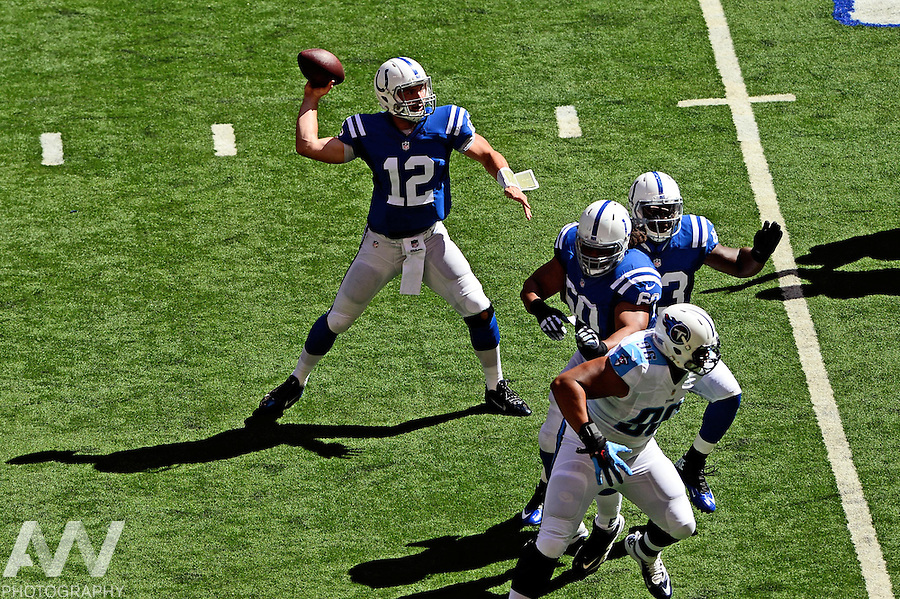 Sep 28, 2014; Indianapolis, IN, USA; Indianapolis Colts quarterback Andrew Luck (12) drops back to pass during the second quarter against the Tennessee Titans at Lucas Oil Stadium. Mandatory Credit: Andrew Weber-USA TODAY Sports