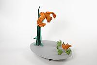 OrigamiUSA 2017 Holiday Tree at the American Museum of Natural History. Base 13 models:<br /> Eagle: Designer &ndash; Nguyen Hung Cuong, Folder &ndash; Ryan Charpentier<br /> Rabbit: Designer &ndash; Ronald Koh, Folder Ryan Charpentier<br /> Tree: Designer &ndash; John Montroll, Folder &ndash; Rosalind Joyce<br /> Grass: Designer &ndash; Delrosa Marshall, Folder &ndash; Delrosa Marshall