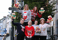 Pictured TOP L-R: Local residents wearing Christmas jumpers Rhian Blackford and and Linda Adams-Lewis. FRONT L-R Ruth Martin, Kathryn Pyart, Del Bennett and Donna Bentley in Cardigan town centre<br /> Re: The town of Cardigan in west Wales will be temporarily renamed Jumper tomorrow (Thursday).