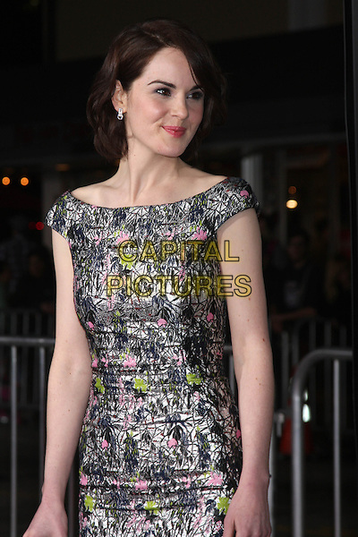 LOS ANGELES, CA - FEBRUARY 24: Michelle Dockery at the &quot;Non-Stop&quot; Premiere, Village Theater, Westwood,  February 24, 2014. <br /> CAP/MPI/JO<br /> &copy;JO/MPI/Capital Pictures