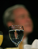 United States President George W. Bush, as seen through his water glass as he listens to a speaker at the 56th National Prayer Breakfast at the Washington Hilton Hotel in Washington, DC. on February 7, 2008.  <br /> Credit: Dennis Brack / Pool via CNP