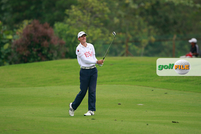 Christian Cevaer (FRA) plays his 2nd shot on the 14th hole during Friday's Round 2 of the 2011 Iskandar Johor Open, Horizon Hills Golf Club, Johor, Malaysia, 18th November 2011 (Photo Eoin Clarke/www.golffile.ie)