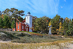The 40 Mile Point Lighthouse as it looks out over Lake Huron on a lazy autumn afternoon, Rogers City, Michigan, Lower Peninsula, USA