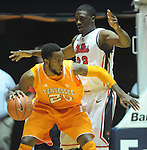 "Tennessee's Kenny Hill (20)  works against Mississippi's Reginald Buckner (23) at the C.M. ""Tad"" Smith Coliseum on Thursday, January 24, 2013. (AP Photo/Oxford Eagle, Bruce Newman)"