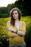 Young woman standing in open meadow