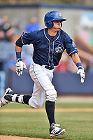 Asheville Tourists designated hitter Jose Gomez (4) runs to first base during a game against the Greenville Drive at McCormick Field on April 16, 2017 in Asheville, North Carolina. The Drive defeated the Tourists 4-2. (Tony Farlow/Four Seam Images)
