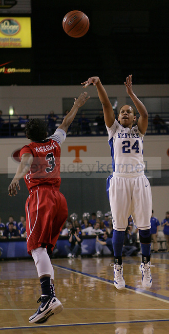 Senior point guard Amber Smith shoots the ball during the first half of UK Hoops vs. Ole Miss at Memorial Coliseum in Lexington, Ky., on Thursday, Feb. 2, 2012. Photo by Tessa Lighty | Staff