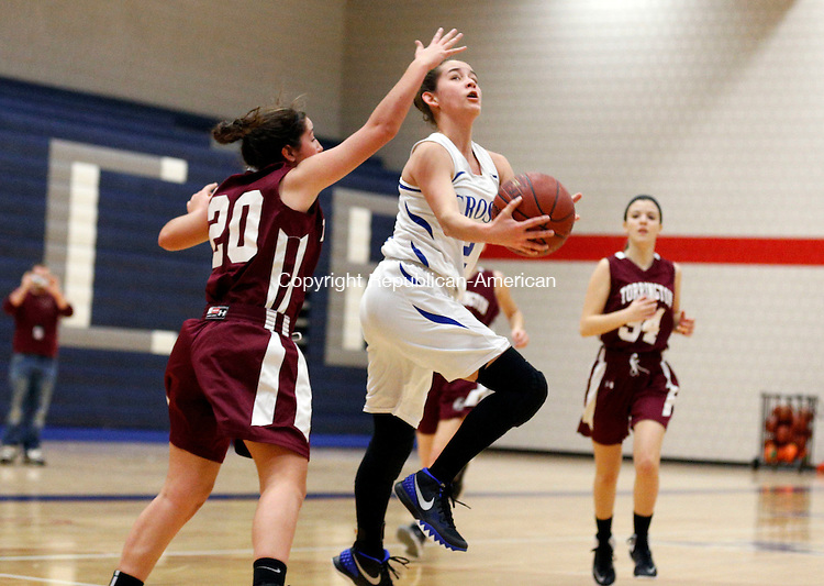 Waterbury, CT- 08 January 2016-010816CM05-  Crosby's Ninoshka Figueroa-Robles  goes to the hoop against Torrington's Shannon Reardon during their NVL matchup in Waterbury on Friday.    Christopher Massa Republican-American