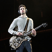 Linkin Park - lead guitarist Brad Delson performing live main stage as the headliner on Day One of the inaugural Sonisphere Festival held in the grounds of Knebworth House, Knebworth, UK - 01 Aug 2009 - Photo by: Zaine Lewis /IconicPix