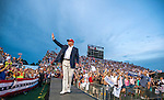 MOBILE, AL- AUGUST 21: U.S. Republican presidential candidate Donald Trump takes the stage at Ladd-Peebles Stadium on August 21, 2015 in Mobile, Alabama. The Donald Trump campaign moved tonight's rally to a larger stadium to accommodate demand.