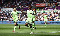 Kelechi Iheanacho of Manchester City celebrates scoring his goal to make the score 0-1 during the Barclays Premier League match between Swansea City and Manchester City played at The Liberty Stadium, Swansea on 15th May 2016