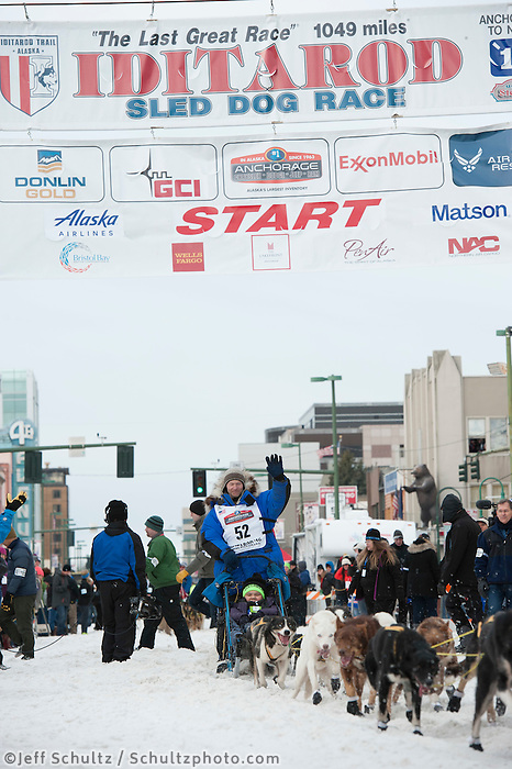Tore Albrigtsen and team leave the ceremonial start line with an Iditarider at 4th Avenue and D Street in downtown Anchorage, Alaska on Saturday, March 5th during the 2016 Iditarod race. Photo by Joshua Borough/SchultzPhoto.com