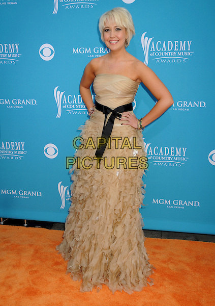 STEEL MAGNOLIA - Meghan Linsey.45th Annual Academy Of Country Music Awards held at the MGM Grand Garden Arena, Las Vegas, NV, USA..April 18th, 2010.full length dress black beige dress strapless ruffles ribbon waist hand on hip.CAP/ADM/BP.©Byron Purvis/AdMedia/Capital Pictures.