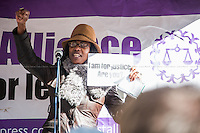Marcia Rigg (Sean Rigg's sister, Justice for Sean Rigg Campaign / Death in Custody Campaign).<br /> <br /> London, 23/02/2015. Today, the &quot;Justice Alliance&quot; and their Chris Grayling puppet dresses as King John Lackland arrived in Westminster for the last day of a tree-day march called &quot;Relay For Rights&quot; from Runnymede, birth place of the Magna Carta, to Old Palace Yard, where they held the &quot;Not the Global Law Summit&quot; rally. At the end of the demonstration outside the Houses of Parliament, protesters marched peacefully to the Queen Elizabeth II Centre where the &quot;Global Law Summit&quot; was taking place. From the organisers Facebook page: &lt;&lt; [&hellip;] February 23rd 2015 is the 799th and 8 month anniversary of the signing of the Magna Carta. The Government is using this non-anniversary to host the Global Law Summit, &quot;a unique opportunity to explore what the future holds for global business and the rule of law&quot;. This back-slapping corporate jamboree, partly funded by the Ministry of Justice, comes at a time when the same department has waged a slash-and-burn campaign on advice and representation, leaving people without deep pockets unable to get justice in court. Magna Carta represents the oldest historical commitment to equal access to justice in Britain. We are here to remind the Government of its duty to provide access to justice for all, and not merely to the rich. [&hellip;]&gt;&gt;<br /> <br /> For more information please click here: http://bit.ly/1G6aHZx