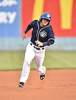 Asheville Tourists second baseman Forrest Wall (7) runs to third during game one of a double header against the Greenville Drive on April 18, 2015 in Asheville, North Carolina. The Tourists defeated the Drive 2-1. (Tony Farlow/Four Seam Images)