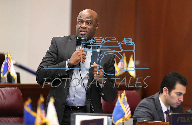 Nevada Sen. Kelvin Atkinson, D-Las Vegas, speaks on the Senate floor at the Legislative Building in Carson City, Nev., on Thursday, April 16, 2015.<br /> Photo by Cathleen Allison