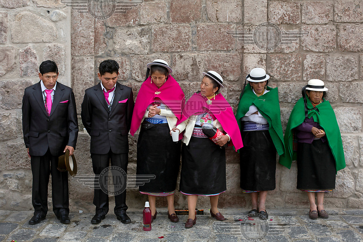 Nicanor Lema (far left), his son Luis Lema, 24, and bride Marimam Cando, 25, (third left) with other female relatives and guests outside the church on on the day Luis and Marimam were married.
