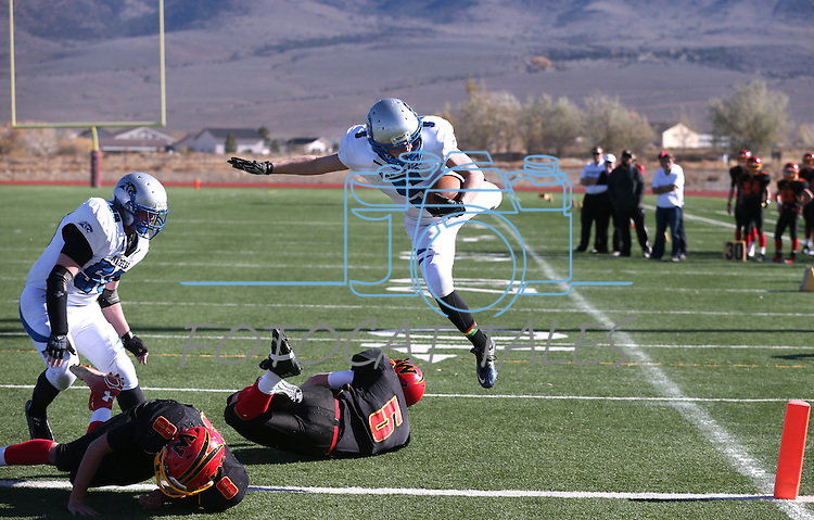 Pahranagat Valley's David Ingram dives into the end zone for a touchdown in the first half of the NIAA DIV championship game against Whittell High at Dayton High School in Dayton, Nev., on Saturday, Nov. 21, 2015. PVHS leads 30-6 at halftime. (Cathleen Allison/Las Vegas Review Journal)