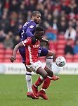 Andy Yiadom of Barnsley and Leon Clarke of Sheffield Utd during the championship match at the Oakwell Stadium, Barnsley. Picture date 7th April 2018. Picture credit should read: Simon Bellis/Sportimage