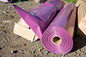 This roll of material is used to cover a pipe to protect it against corrosion while the purple color identifies it as a reclaimed water pipe. The cities of Palo Alto and Mountain View are jointly constructing a reclaimed water pipeline to carry recycled water from the Palo Alto Regional Water Quality Control Plant to customers along East Bayshore Parkway and Mountain View's North Bayshore area.