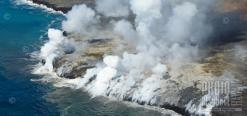 Aerial of Kilauea's lava flowing into the ocean, Kalapana, Big Island.