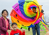 NWA Democrat-Gazette/BEN GOFF @NWABENGOFF<br /> Akshata Nayak, son Surya Nayak, 7, and Harish Nayak of Bentonville goof around with a large wind sock Saturday, March 23, 2019, during the 29th annual Eureka Springs Kite Festival hosted by Turpentine Creek Wildlife Refuge in Eureka Springs. The free family event included kite making and kites for sale from Keleidokites in Eureka Springs and a variety of food trucks and entertainment. Strong wind kept dozens of kites flying high at any given time.