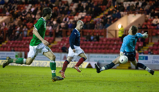 Leigh Griffiths scores for Scotland.