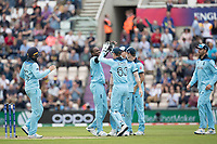 The England players celebrate with Jofra Archer (England) the wicket of Sheldon Cottrell (West Indies) during England vs West Indies, ICC World Cup Cricket at the Hampshire Bowl on 14th June 2019