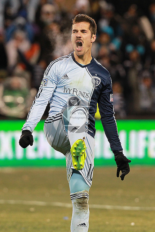 Sporting KC midfielder Benny Feilhaber (10) celebrates after his kick went into the goal during the shootouts. Sporting KC defeated Real Salt Lake in a shootout after the score was tied 1-1 at the end of regulation play in the MLS Cup 2013 championship held at Sporting Park in Kansas City, Kansas on Saturday December 7, 2013.