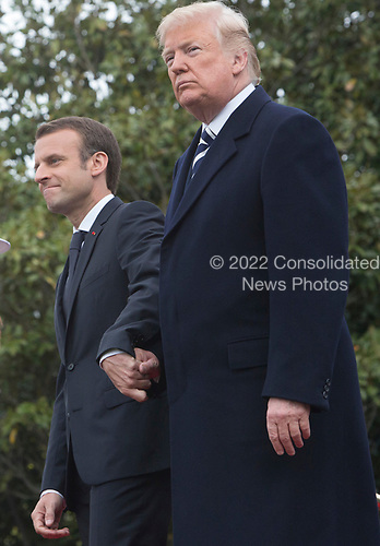 United States President Donald J. Trump and President Emmanuel Macron of France show support for each other during a state visit to The White House in Washington, DC, April 24, 2018. Credit: Chris Kleponis / Pool via CNP