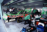 Jimmy Makar and Bobby Labonte talk in the garage at Homestead-Miami Speedway in November 2000. (Photo by Brian Cleary)