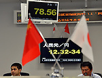 June 1, 2012, Tokyo, Japan - Japanese and Chinese flags adorn the trading table as the two countries start direct currency trading on Friday, June 1, 2012. Foreign exchange traders began swapping Japanese yen for the Chinese unit without having to use the US dollar as an intermediary currency when the market opened in Tokyo. (Photo by Natsuki Sakai/AFLO) AYF -mis-