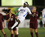 2 December 2005: UCLA's Danesha Adams (25) finds herself between FSU's Libby Gianeskis (12) and Sel Kuralay (r). The UCLA Bruins defeated the Florida State Seminoles 4-0 in their NCAA Division I Women's College Cup semifinal at Aggie Soccer Stadium in College Station, TX.
