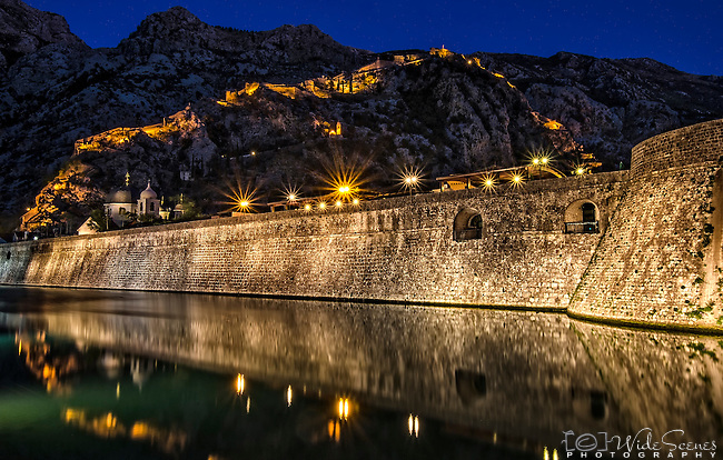 The Blue Hour illuminates the mountains behind the medieval walled town of Kotor in Montenegro.