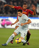 Calcio, Serie A: Roma vs Lazio. Roma, stadio Olimpico, 16 novembre 2008. .Football, Italian serie A: Roma vs Lazio. Rome, Olympic stadium, 16 november 2008..Lazio forward Mauro Zarate, of Argentina, is chased by AS Roma forward Julio Baptista, of Brazil, right..UPDATE IMAGES PRESS/Riccardo De Luca