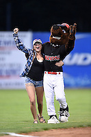 Batavia Muckdogs mascot Homer with a fan after an on field promotion during a game against the Brooklyn Cyclones on August 9, 2014 at Dwyer Stadium in Batavia, New York.  Batavia defeated Brooklyn 4-2.  (Mike Janes/Four Seam Images)