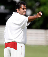 Hornsey captain Chetan Patel directs his field during the Middlesex County League Division Two game between Hornsey and Highgate at Tivoli Road, Crouch End on Saturday Aug 13, 2011