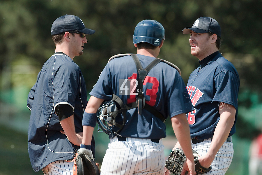 04 June 2010: Starting pitcher Justin Staatz of Rouen talks to Mike Musgrave and Boris Marche during the 2010 Baseball European Cup match won 19-9 by Konica Minolta Pioniers over the Rouen Huskies, at the Kravi Hora ballpark, in Brno, Czech Republic.