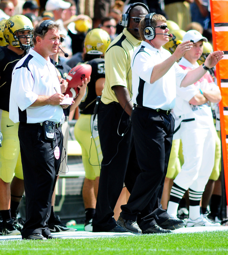 06 September 08: Colorado defensive passing game coach Greg Brown, left, anbd head coach Dan Hawkins watch a game against Eastern Washington. The Colorado Buffaloes defeated the Eastern Washington Eagles 31-24 at Folsom Field in Boulder, Colorado. FOR EDITORIAL USE ONLY