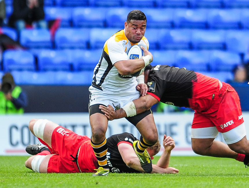 Wasps' Siale Piutau is tackled by Saracens' Billy Vunipola<br /> <br /> Photographer Craig Thomas/CameraSport<br /> <br /> Rugby Union - European Rugby Champions Cup Semi Final - Saracens v Wasps - Saturday 23rd April 2016 - Madejski Stadium - Reading<br /> <br /> &copy; CameraSport - 43 Linden Ave. Countesthorpe. Leicester. England. LE8 5PG - Tel: +44 (0) 116 277 4147 - admin@camerasport.com - www.camerasport.com