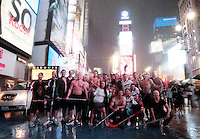 Members of the Vancouver Fire Department play a friendly game of hockey in Times Square in the pouring rain as Hurricane Irene makes it way towards the city on August 27, 2011 in New York, New York. (Photo by Jared Wickerham/Getty Images)
