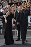 Angelina Jolie, Brad Pitt<br /> 'World War Z' world premiere, Empire cinema, Leicester Square, London, England 2nd June 2013 <br /> full length black dress suit sunglasses shades goatee facial hair couple holding hands<br /> CAP/PL<br /> &copy;Phil Loftus/Capital Pictures /MediaPunch ***NORTH AND SOUTH AMERICAS ONLY***