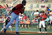 Kannapolis Intimidators first baseman Corey Zangari (25) holds runner Greg Cullen (18) of the Rome Braves as starting pitcher Johan Dominguez (31) looks to his catcher for the sign at Kannapolis Intimidators Stadium on July 3, 2019 in Kannapolis, North Carolina.  The Braves defeated the Intimidators 13-11, (Brian Westerholt/Four Seam Images)